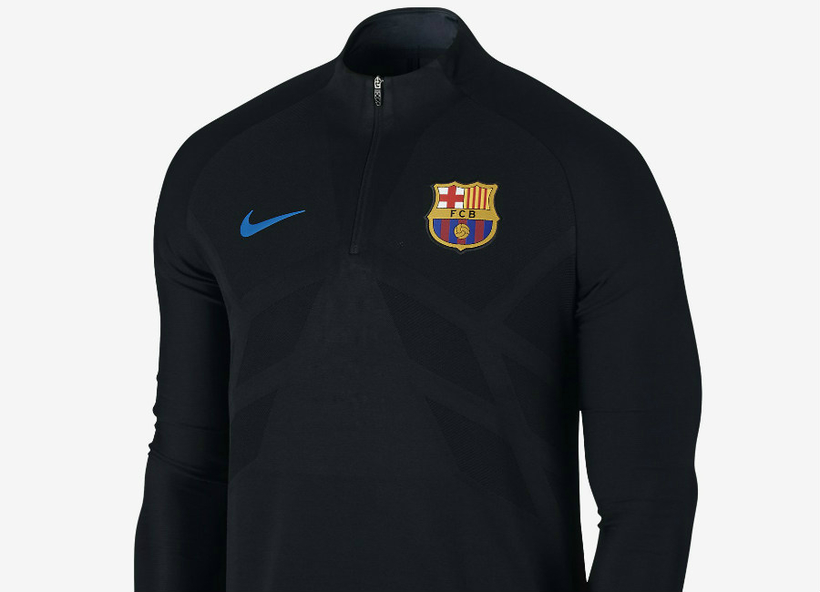 5a5f7625c84 The Nike FC Barcelona AeroSwift Strike Drill Football Top features  breathable stretch fabric to help you stay cool and quick on the pitch.