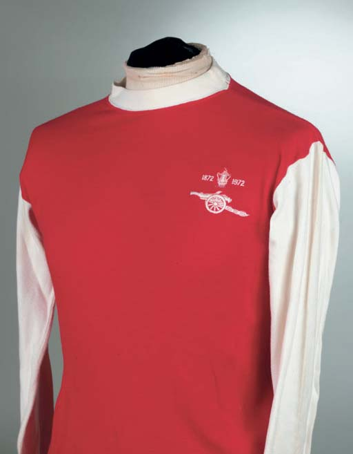 A RED AND WHITE 1972 ARSENAL F.A.CUP FINAL SHIRT No.8, with crew-neck collar and embroidered badge, inscribed 1872, 1972 . The above shirt was worn by Alan Ball in the 1972 Centenary F.A.Cup Final. In the match played on 6th May 1972 at Wembley Leeds United defeated Arsenal 1-0