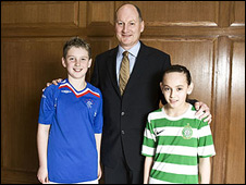 Old Firm sponsor Carling is to remove its logo from Rangers and Celtic children's football tops