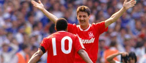 Ian Rush celebrates another FA Cup Final goal with John Barnes.