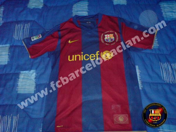 "This is believed to be the new Barcelona home shirt for the 2007/2008 season. Both shirts are a tribute to the club's 50 years at their Nou Camp with gold embroidery around the Barcelona's badge on the shirt. Around the badge :  ""Camp Nou"" and""1957-2007″."
