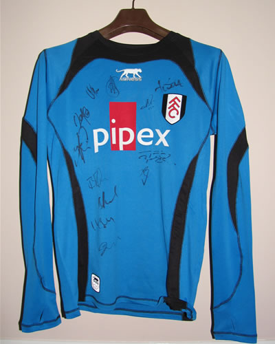 Rare Fulham shirt accordingly never worn by the team with 12 players autographs.