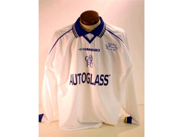 "186. Shirt: A white with blue & yellow trim Chelsea Shirt with embroidered badge and ""UEFA Cup Winners Cup Winners 1998"" to front and No. 24 Newton to rear. £120-150"