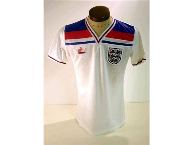 317. England International Shirt: A white with red & blue V-neck shirt with embroidered 3 Lions badge to front, No. 6 to rear also official Itinerary & programme. (3). £250-300