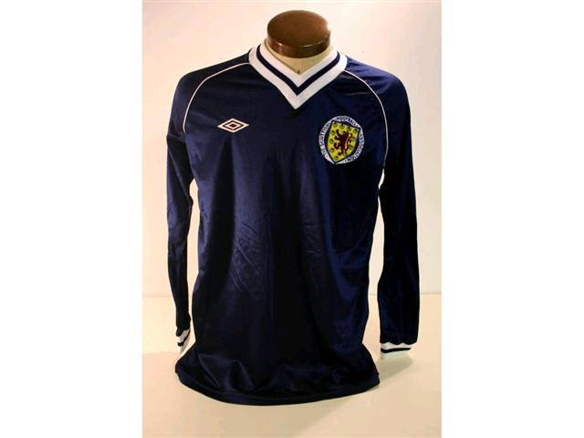 318. Scotland International Shirt: A blue with white trim V-neck shirt with embroidered badge to front, No 16 to rear. £250-300