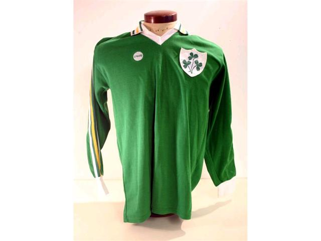 319. Republic of Ireland International Shirt: A green with white & yellow trim V-neck shirt with embroidered Shamrock badge to front, No. 15 to rear plus exchange gift from the match, itinerary and programme. £200-250
