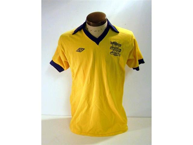 441. Players Shirt: A yellow with blue trim short sleeve Birmingham City shirt c1980 with embroidered crest to front, No. 11 to rear. £100-120.