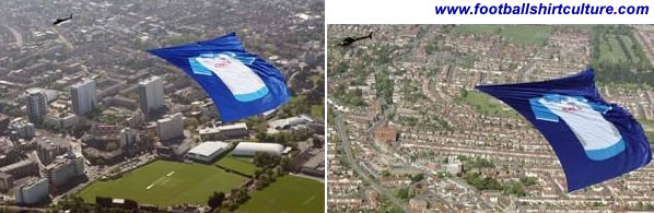 Pompey fans have been looking skywards this morning as a giant shirt is being flown around the city. A helicopter trailing a 184 feet by 131 feet Portsmouth shirt courtesy of the club's sponsor OKI Printing Solutions is being pulled across the city's sky.