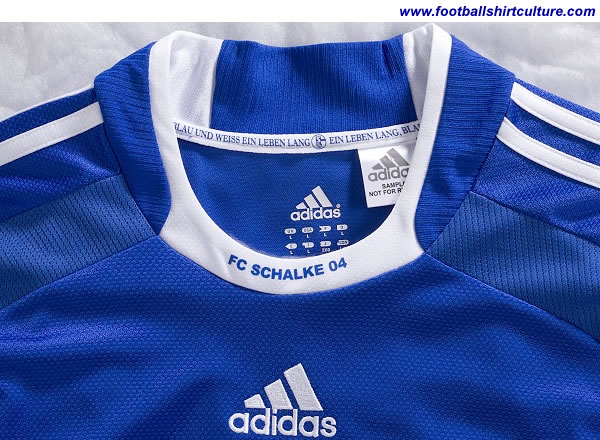 "This is the first time the words ""Schalke 04"" appear at the front of the collar. And in the neck band, anyone can read about what the institution motto is :""EIN LEBEN LANG, BLAU UND WEISS EIN LEBEN LANG"" which means something like :  ""A MY LIFE, BLUE AND WHITE ALL MY LIFE."""