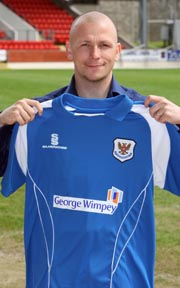 Jody Morris, shows the new 08/09 St. Johnstone home shirt, which sees a return to the traditional blue home shirt.